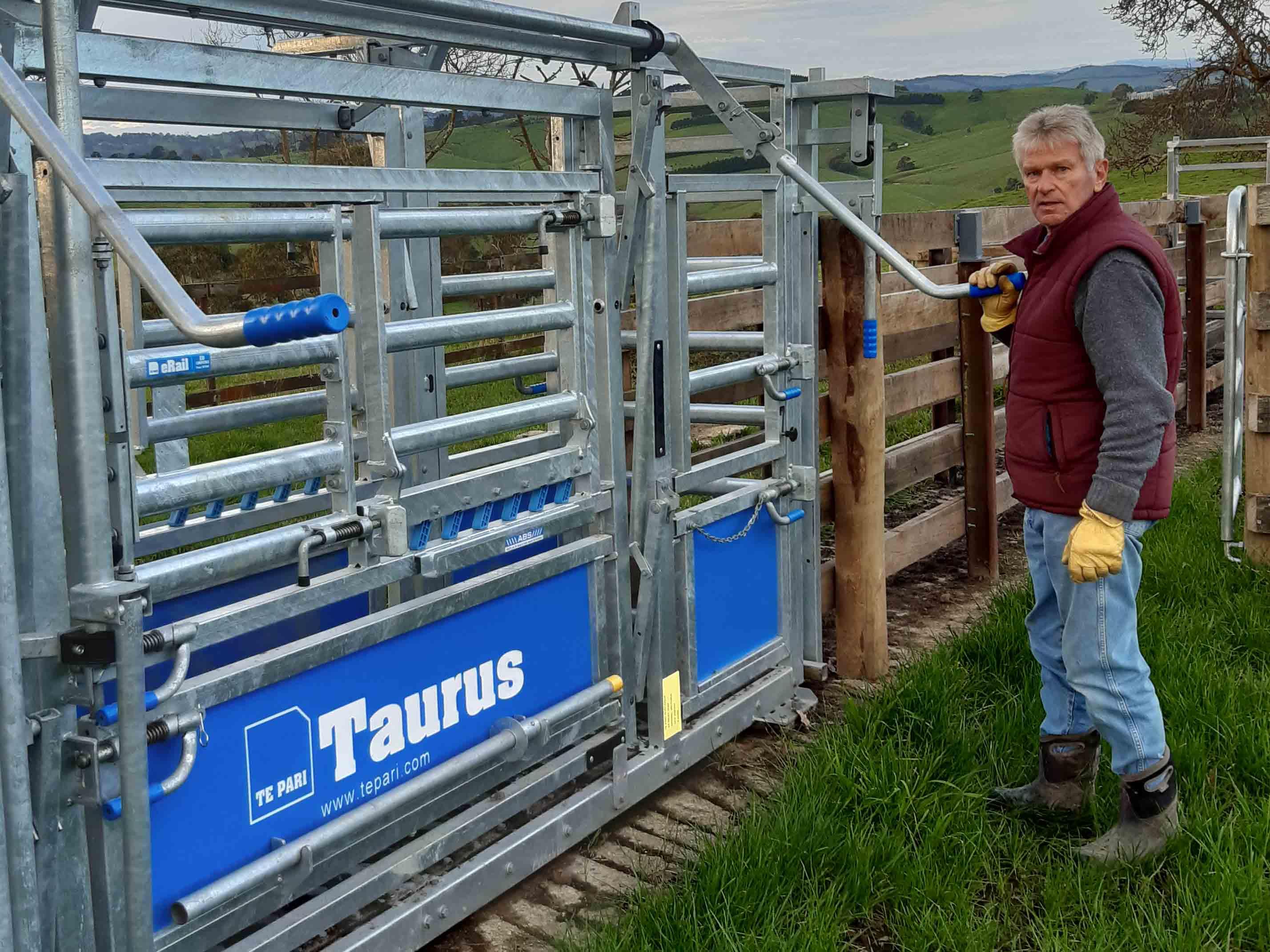 bruce clark with his taurus cattle crush by te pari australia showing rear handle