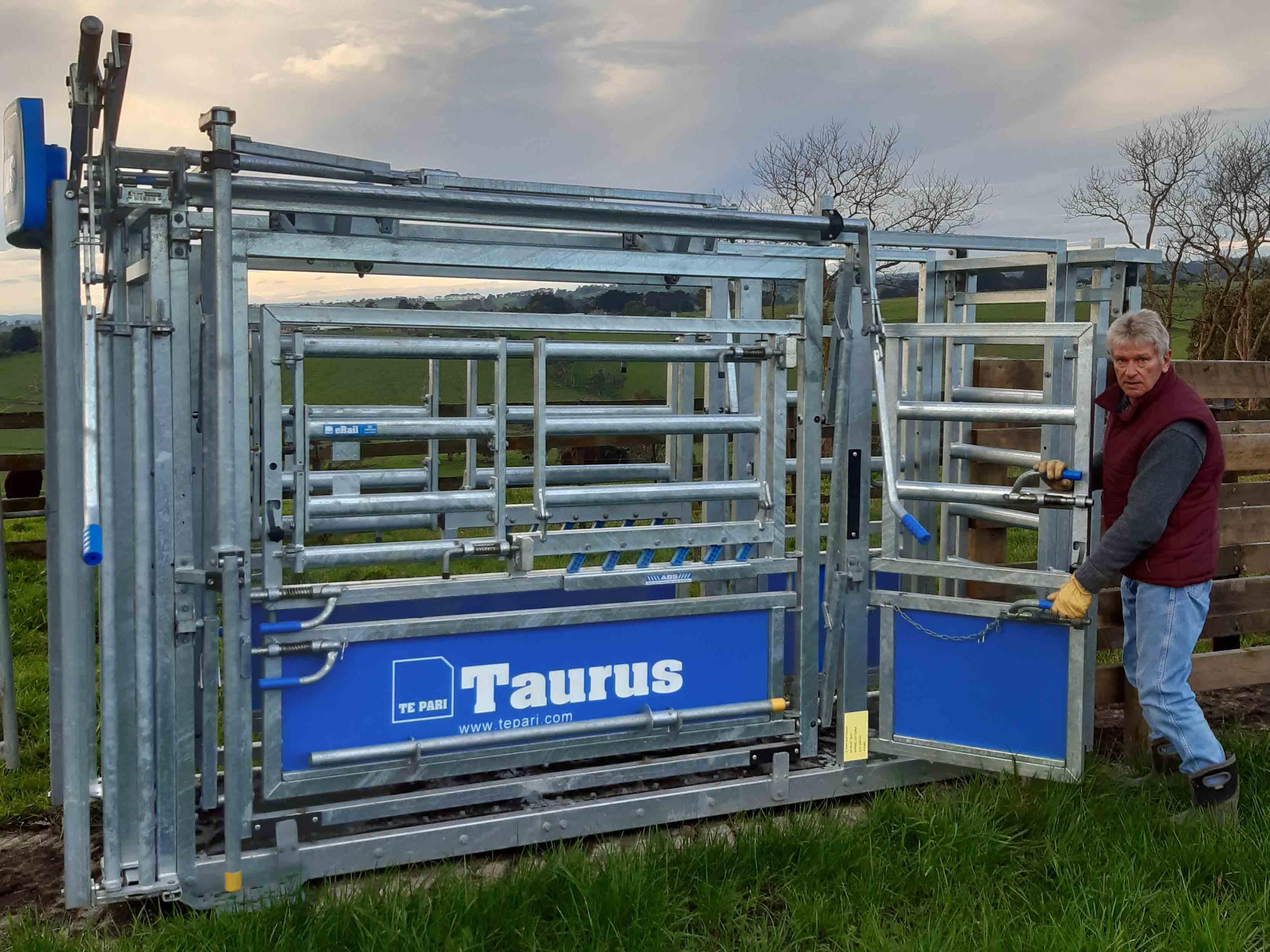 bruce clark with his taurus cattle crush by te pari australia showing side gates